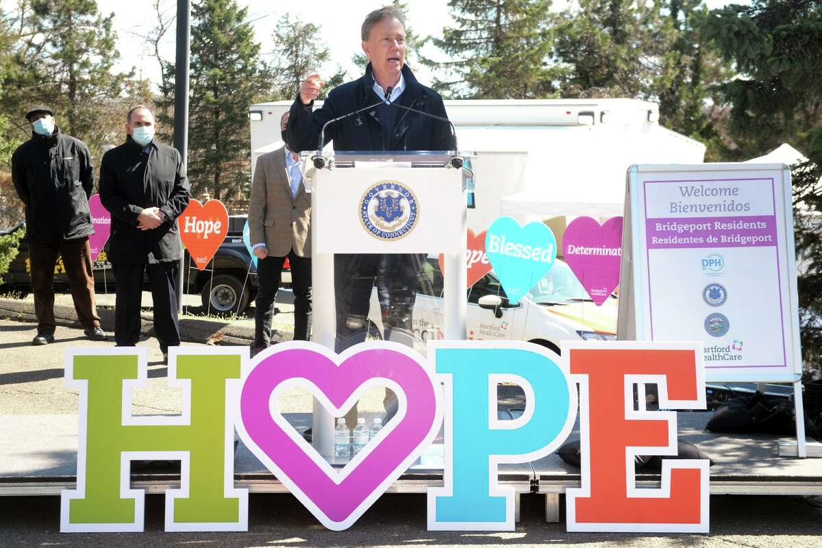 Gov. Ned Lamont speaks at a news conference at Connecticut's Beardsley Zoo, in Bridgeport, Conn. March 29, 2021. Lamont joined others to announce the deployment of FEMA's new COVID-19 mobile vaccination unit, which is set up and running this week in the zoo's parking lot.