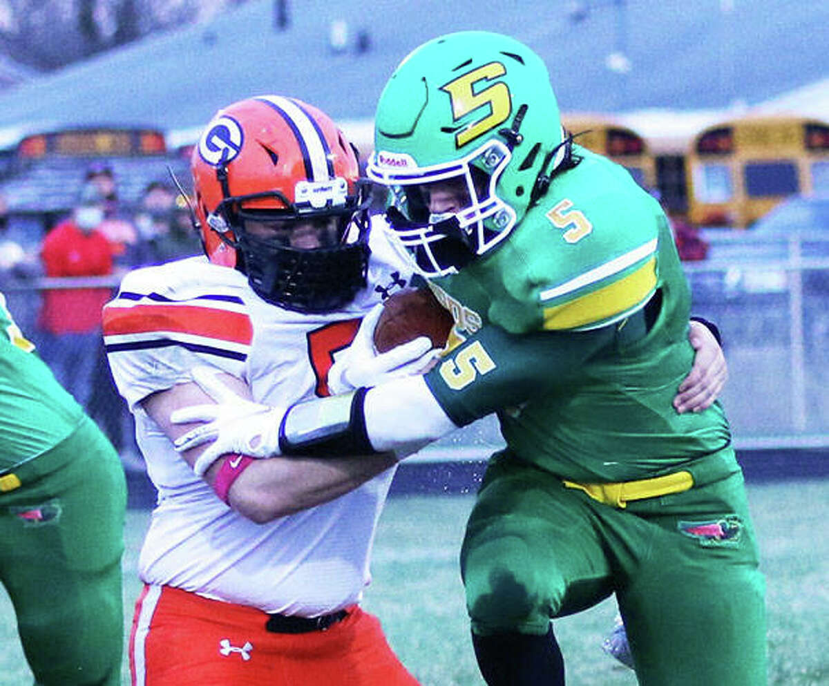 Southwestern RB Gavin Day (5) is hit by Gillespie LB Zane Cunningham in their SCC football game Friday night in Piasa.