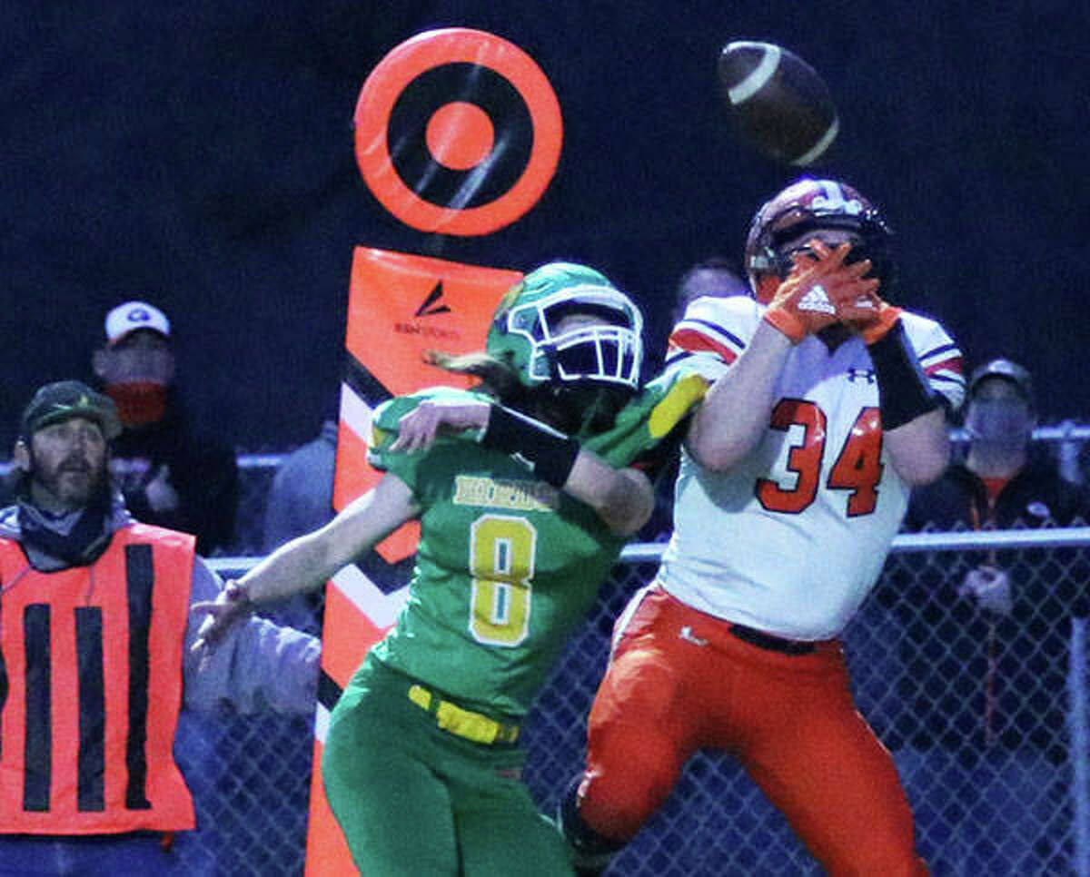 Southwestern's Sam Robinson (8) breaks up a pass intended for Gillespie's John Berry in the second half of the Piasa Birds' 34-24 victory Friday night at Knapp Field in Piasa.