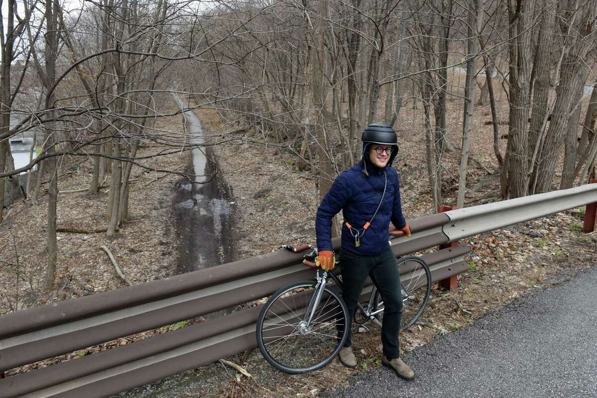 Daniel Morrissey of Troy Architecture Program and Transport Troy is pictured above a section of the Troy Rail Trail that runs along the bottom of Oakwood Cemetery on Monday, March 29, 2021, in Troy, N.Y. Accessible transportation advocates have designed a new map, the Troy Trails Map, to bring attention to the wealth of natural resources and recreation infrastructure in and around the city. (Will Waldron/Times Union)