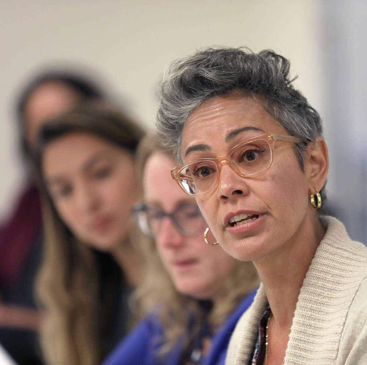 Alison Collins, right, is seen during an editorial board meeting Sept. 26, 2018, in San Francisco.