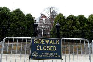 A security fence blocks access to the sidewalk in front of the Executive Mansion on Monday, March 29, 2021, on Eagle Street in Albany, N.Y.  (Will Waldron/Times Union)