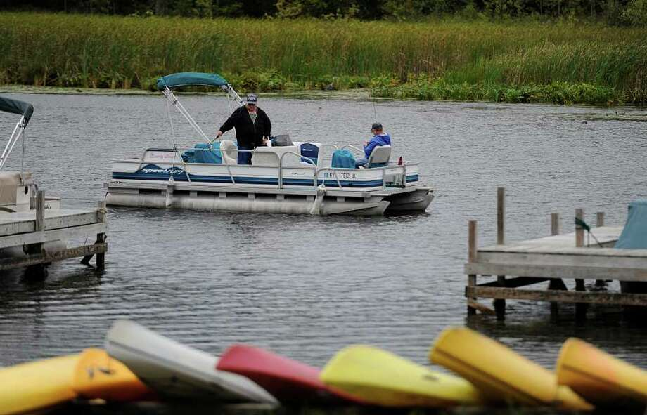 A fisherman casts in to the north end of Saratoga Lake on Thursday as a state proposal asks that visible waterborne pests be removed from all boats before launching in state waters. (Skip Dickstein/Times Union) Photo: Skip Dickstein / 2008