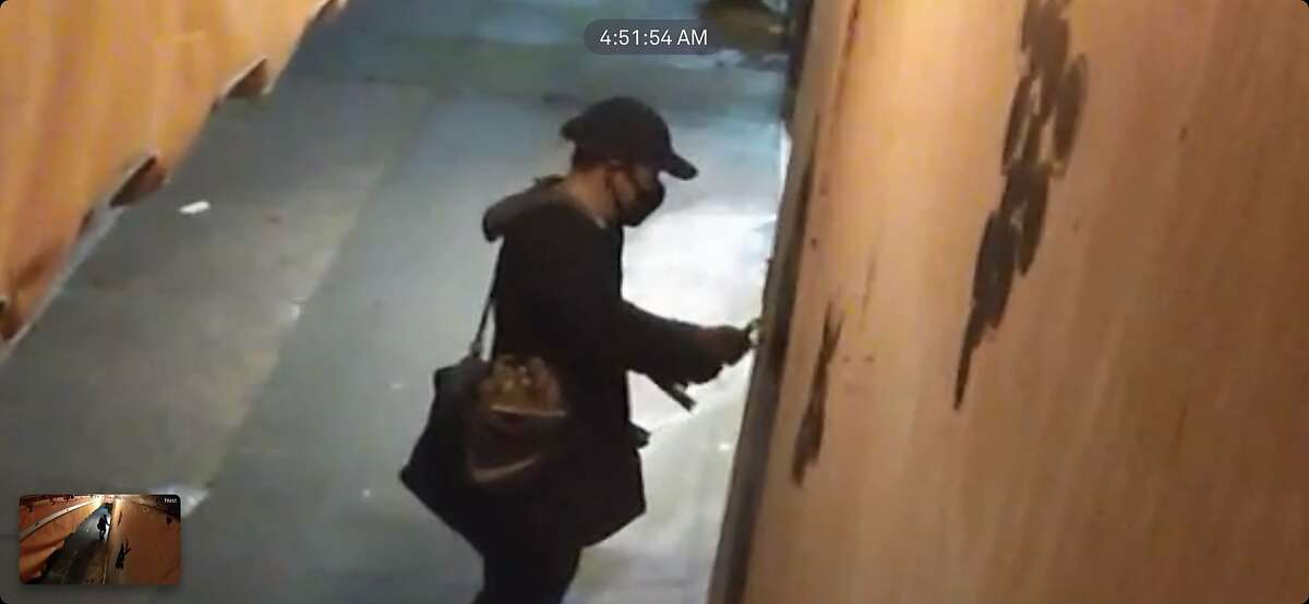 Security footage from Biondivino, a wine shop in S.F., shows a person attempting to break in on March 18 using a crowbar.