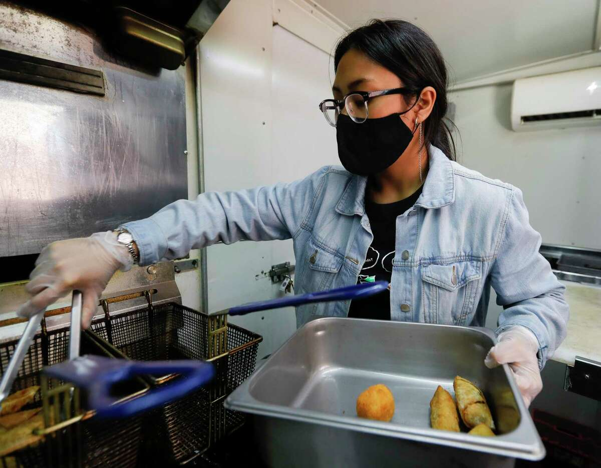 Kahlia Cheng takes friend food out to further prepare at Taste The Asian food truck, Friday, March 26, 2021, in Conroe.