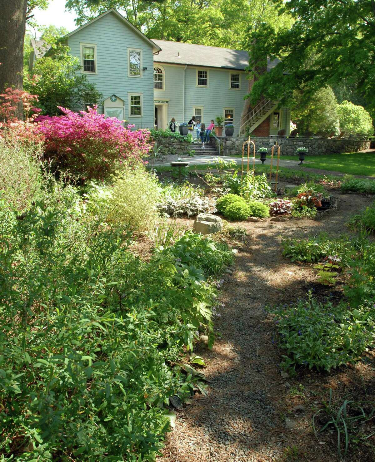 The cottage garden in front of the visitor center at Bartlett Arboretum and Gardens is full of blooming flowers.