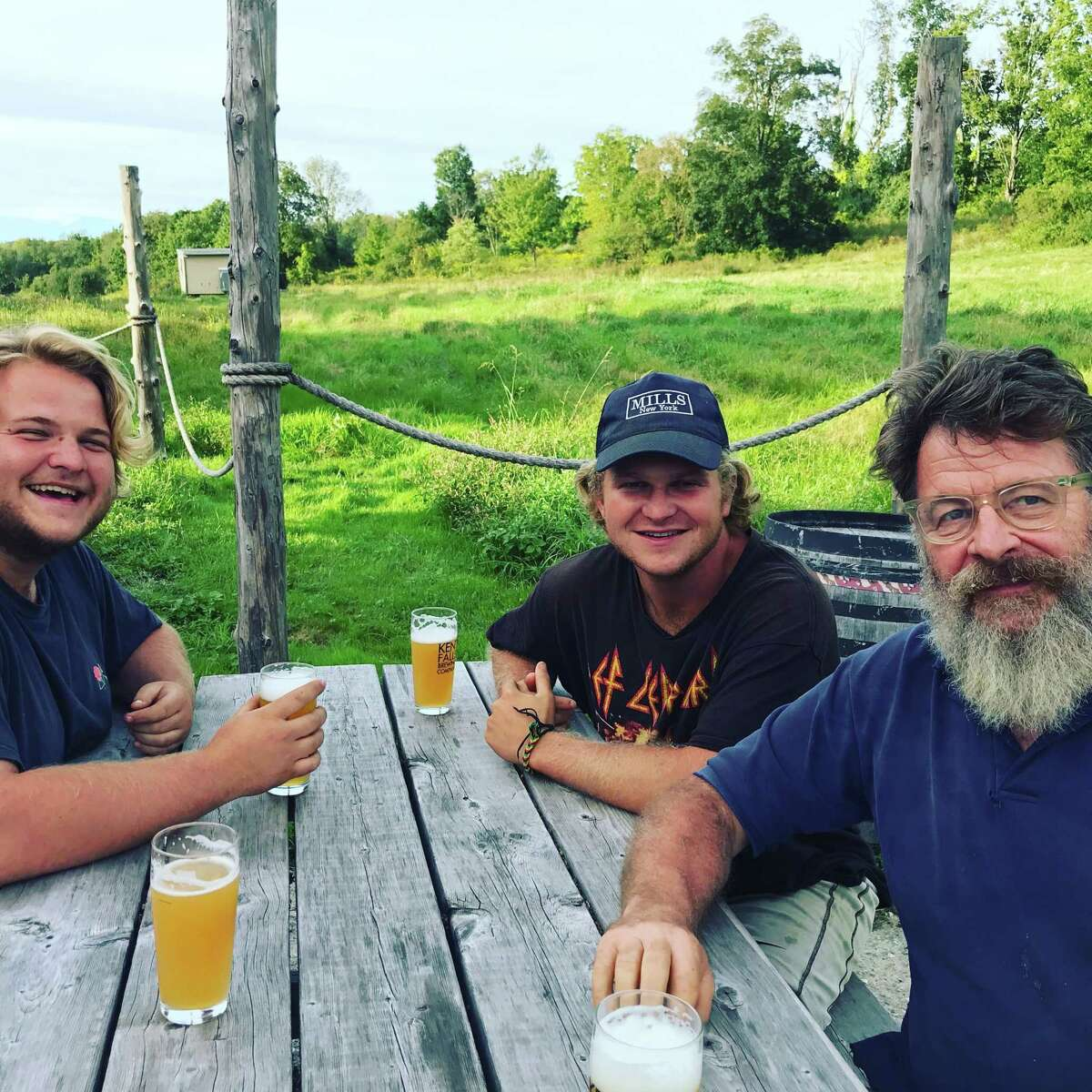 Dr. James Shepherd (right) enjoys the fruit of his labors with sons James McD (middle) and George W (left), who have worked in the hopyard every summer.