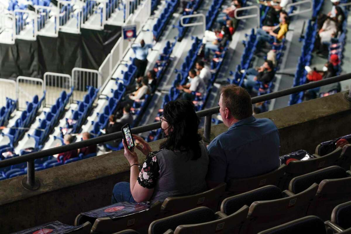 Fans are seen in the stands during player introductions before a game in the Sweet 16 round of the women's NCAA Tournament on Saturday at the Alamodome in San Antonio.