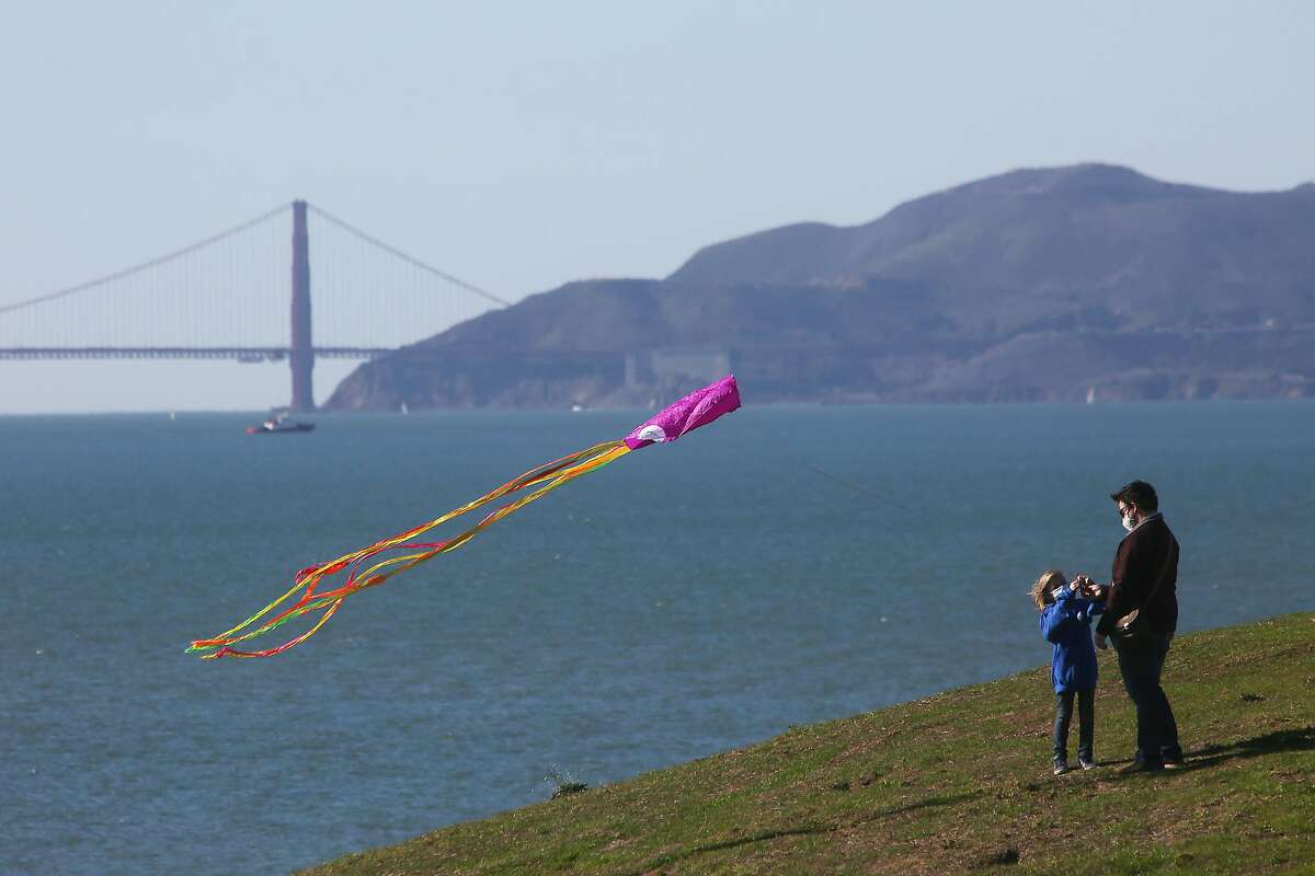 It could be a good time to fly a kite, as Richmond's Adam Gerardin did with daughter Nia, 6, in Berkeley in January.