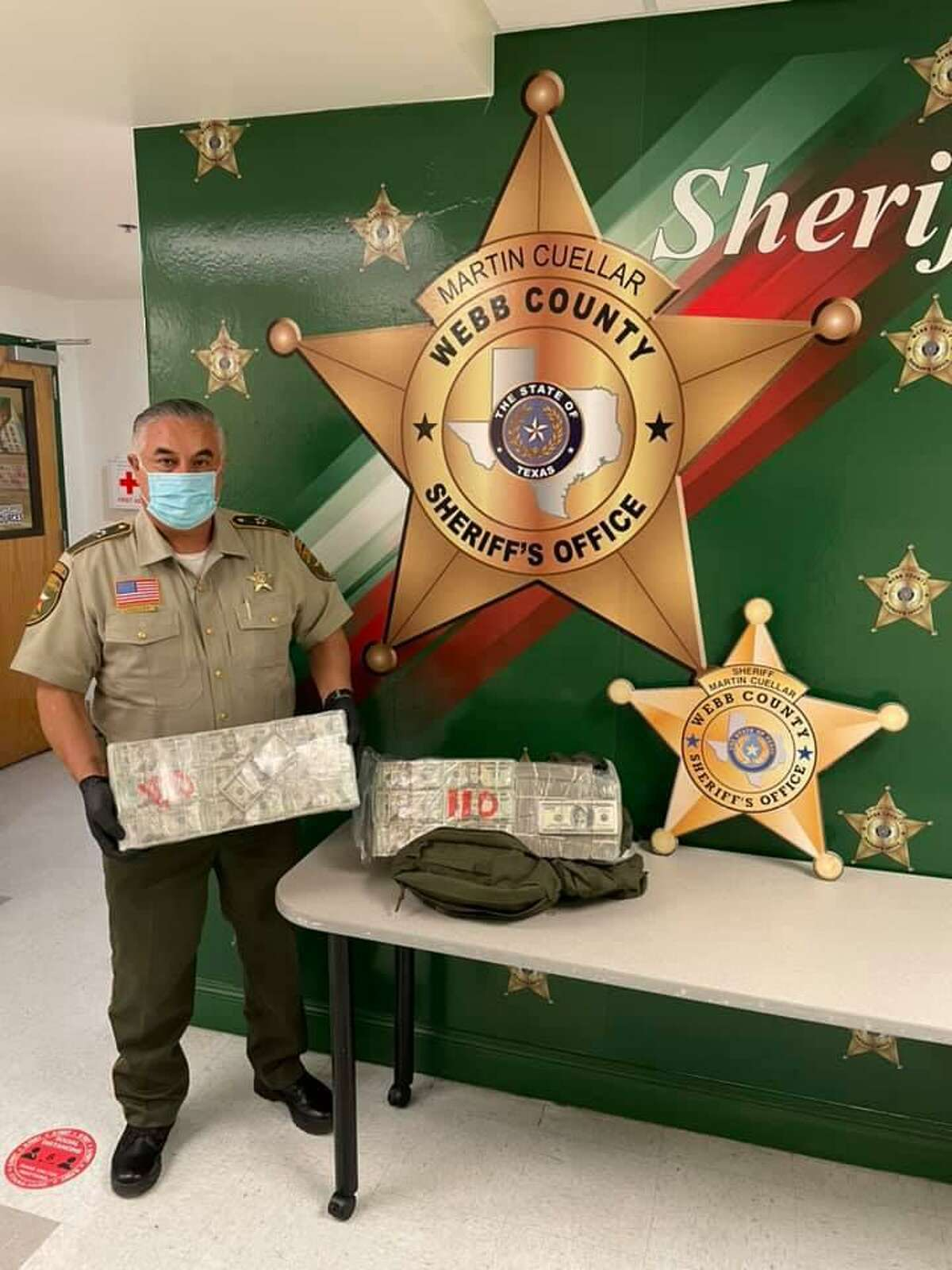 Webb County Sheriff Martin Cuellar said deputies seized more than $200,000 on Saturday following a traffic stop north of Laredo. A man was detained and released pending further investigation.