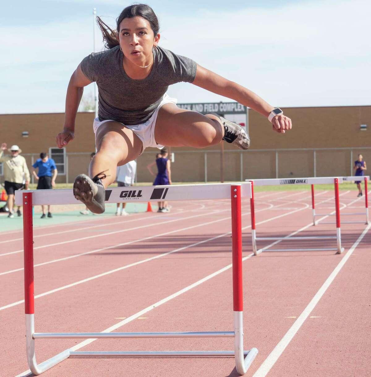 Midland High's Taylor Gonzalez practices the hurdles 03/26/21 at Memorial Stadium. Tim Fischer/Reporter-Telegram