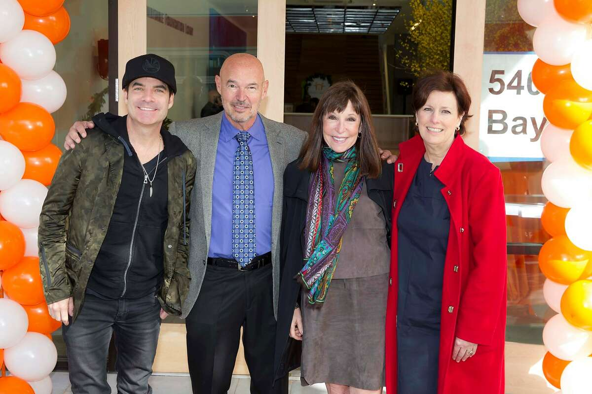 Train lead singer Pat Monahan, Stephen and Nancy Grand, and Family House CEO Alexandra Morgan at the groundbreaking of the Nancy and Stephen Grand Family House in March 2015.