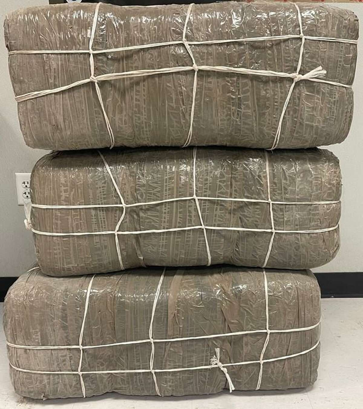 U.S. Border Patrol agents said they seized these 216.3 pounds of marijuana with an estimated value of $173,040.