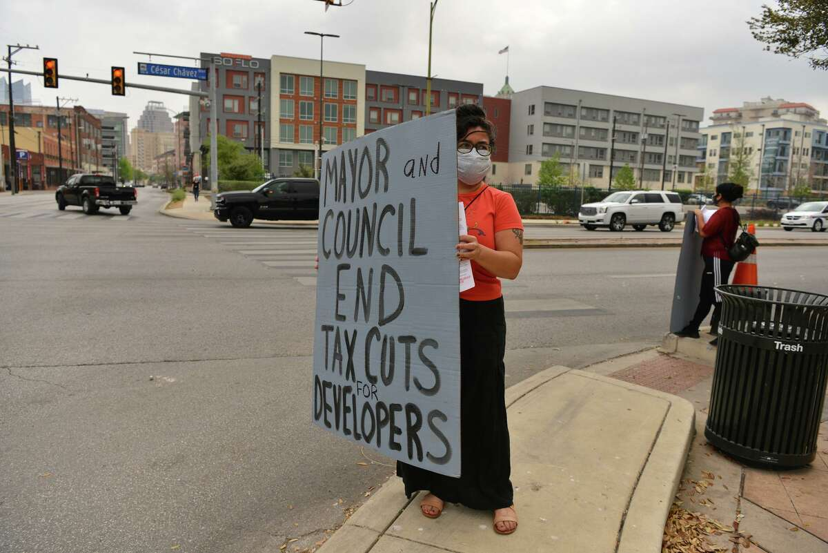 Jessica Guerrero holds a sign during a protest Saturday in downtown San Antonio.