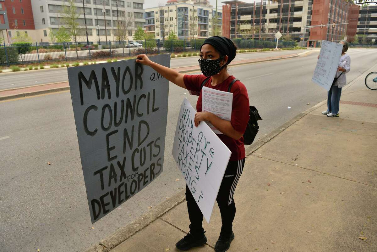 Fabiola Torralba carries signs during the event.