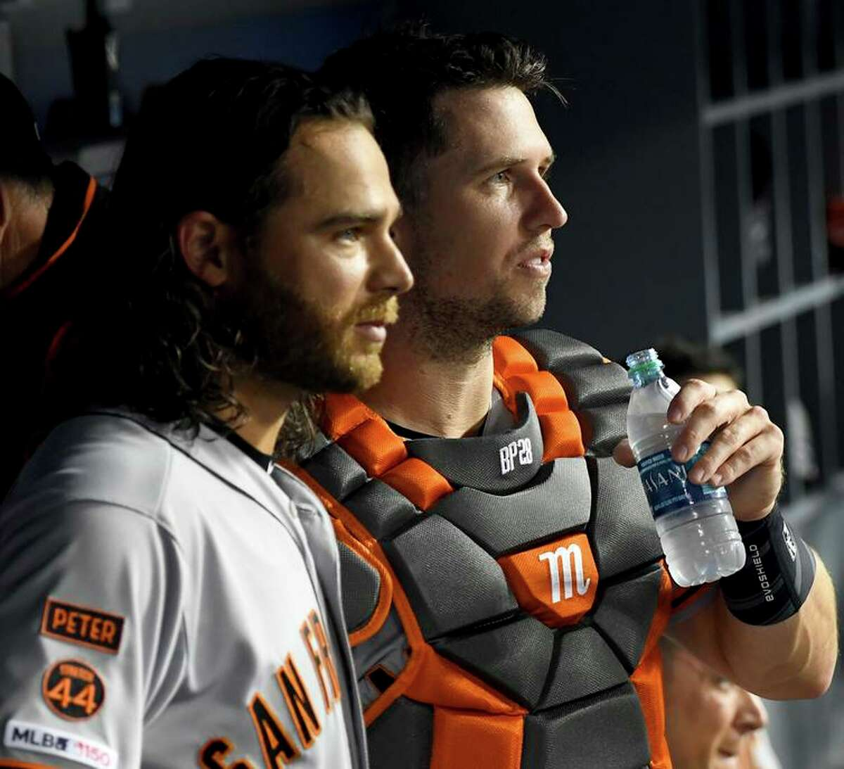 LOS ANGELES, CA - APRIL 01: Brandon Crawford #35 and Buster Posey #28 of the San Francisco Giants look on from the dugout during the game against the Los Angeles Dodgers at Dodger Stadium on April 1, 2019 in Los Angeles, California. (Photo by Jayne Kamin-Oncea/Getty Images)