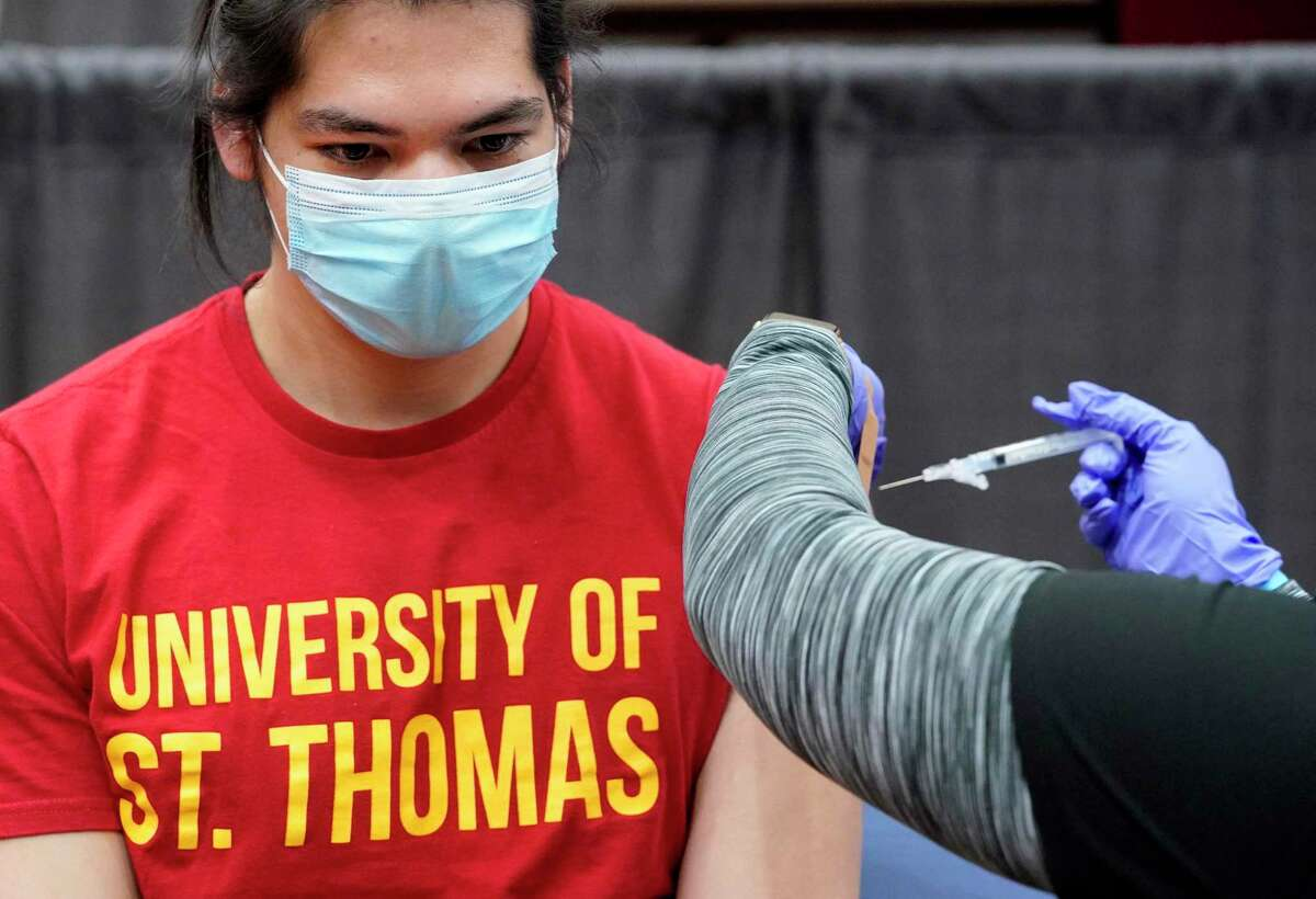 Jordan Habibi, 22, a senior at the University of St. Thomas from Katy, receives a Moderna COVID-19 vaccine from a nurse with the Houston Health Dept. during a vaccination event at the University of Houston Monday, March 29, 2021 in Houston. Monday is the first day all adults in Texas are eligible for the COVID-19 vaccine. Mayor Sylvester Turner announced the