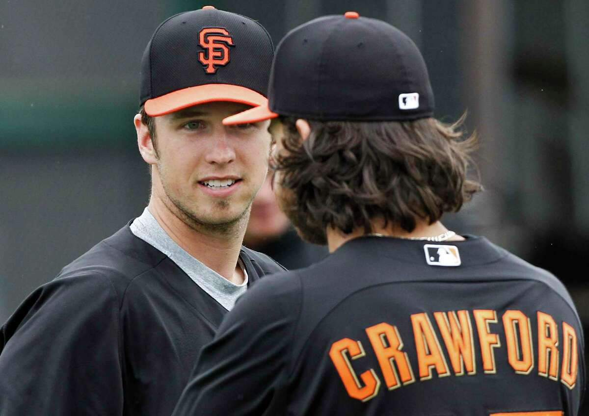 Giants' catcher Buster Posey (28) with infielder Brandon Crawford, (35) during morning workouts as the San Francisco Giants prepare to take on the Kansas City Royals in a Spring Training match up at Scottsdale Stadium on Saturday Mar. 9, 2013, in Scottsdale, Az.