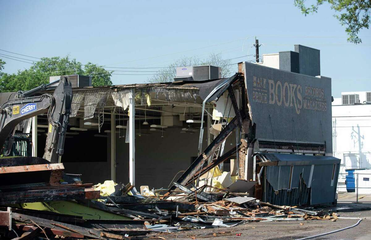 A crew razes the commercial building at the southwest corner of Montrose Boulevard and Westheimer in March.