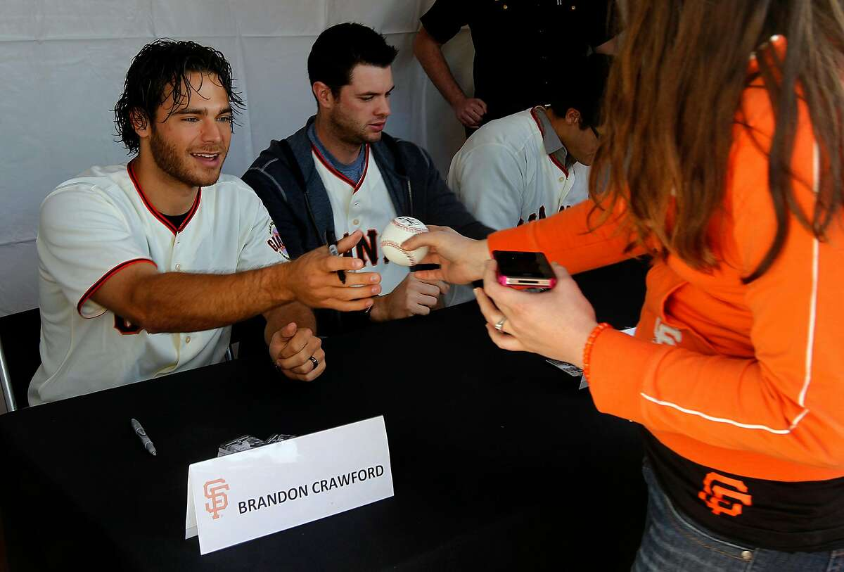 A pair of Brandons: Crawford and Belt sign autographs during 2012's Giants FanFest.