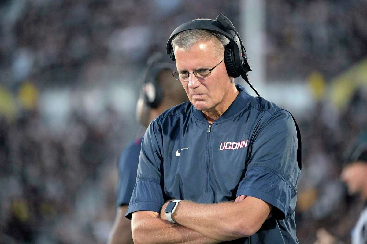 Connecticut head coach Randy Edsall walks along the sideline during the first half of an NCAA college football game against Connecticut Saturday, Sept. 28, 2019, in Orlando, Fla. (AP Photo/Phelan M. Ebenhack)