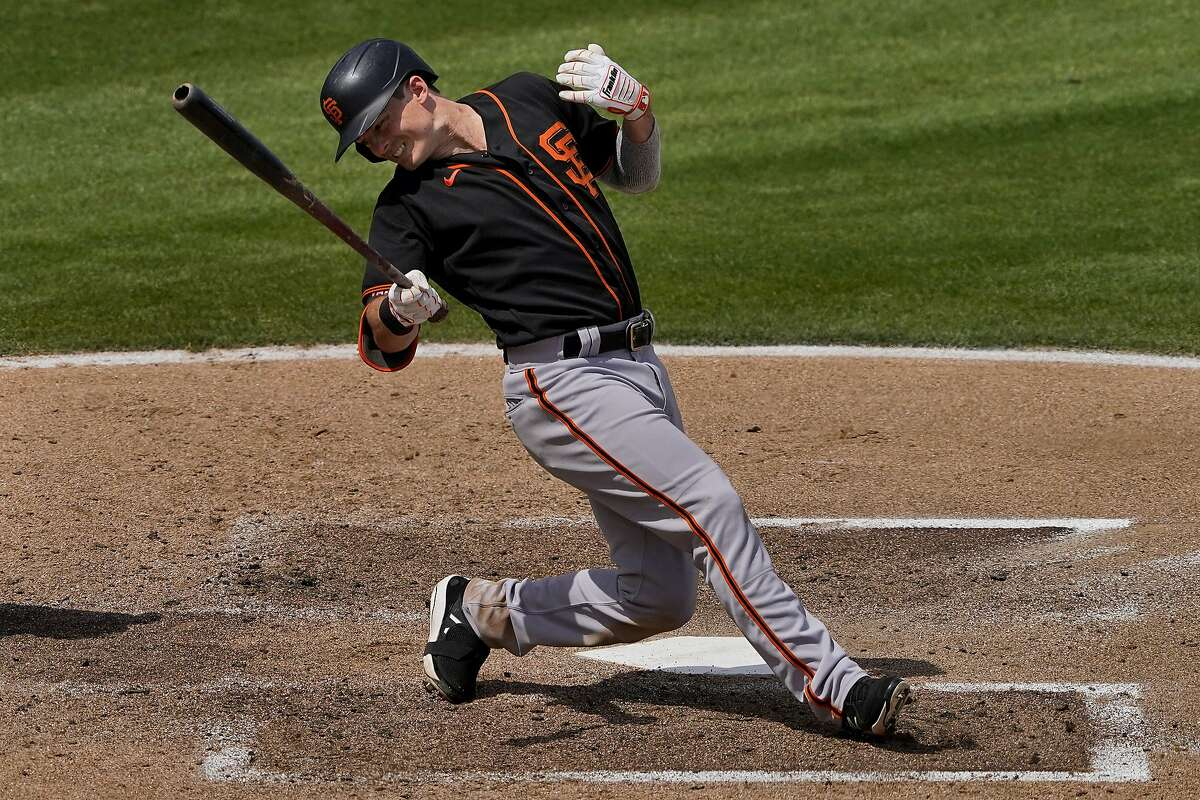 San Francisco Giants' Mike Yastrzemski falls after being hit by a pitch during the third inning of Monday's game.