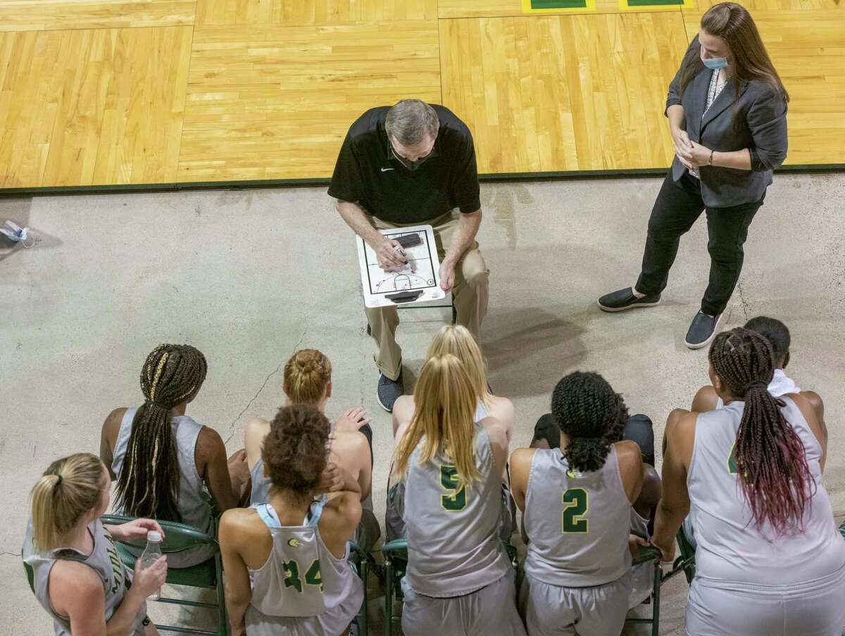 Midland College coaches Ron Jones and Ginger Gatliff talk with players during a timeout against Clarendon College 03/29/21 at the Chaparral Center. Tim Fischer/Reporter-Telegram