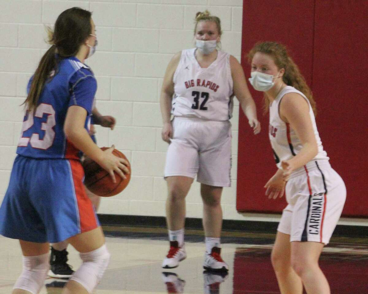 Ariana Costie (right) and Alissa Ruggles (32) were the two graduating seniors for the Big Rapids girls basketball team this season. (Pioneer photo/John Raffel)
