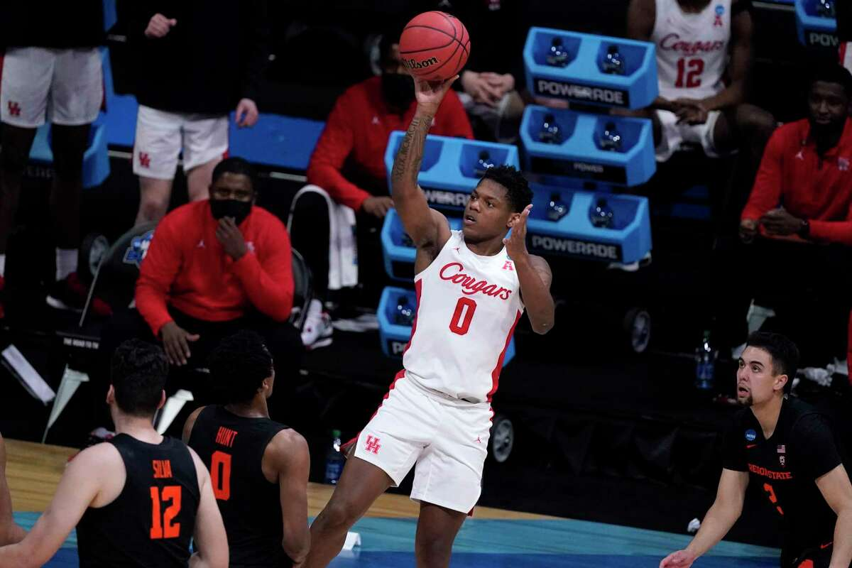Houston guard Marcus Sasser (0) shoots against Oregon State during the second half of an Elite 8 game in the NCAA men's college basketball tournament at Lucas Oil Stadium, Monday, March 29, 2021, in Indianapolis. (AP Photo/Michael Conroy)