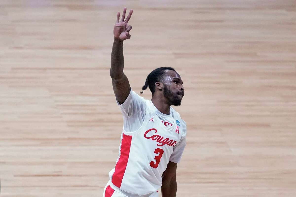 Houston guard DeJon Jarreau (3) reacts to a three-point basket against Oregon State during the second half of an Elite 8 game in the NCAA men's college basketball tournament at Lucas Oil Stadium, Monday, March 29, 2021, in Indianapolis. (AP Photo/Darron Cummings)