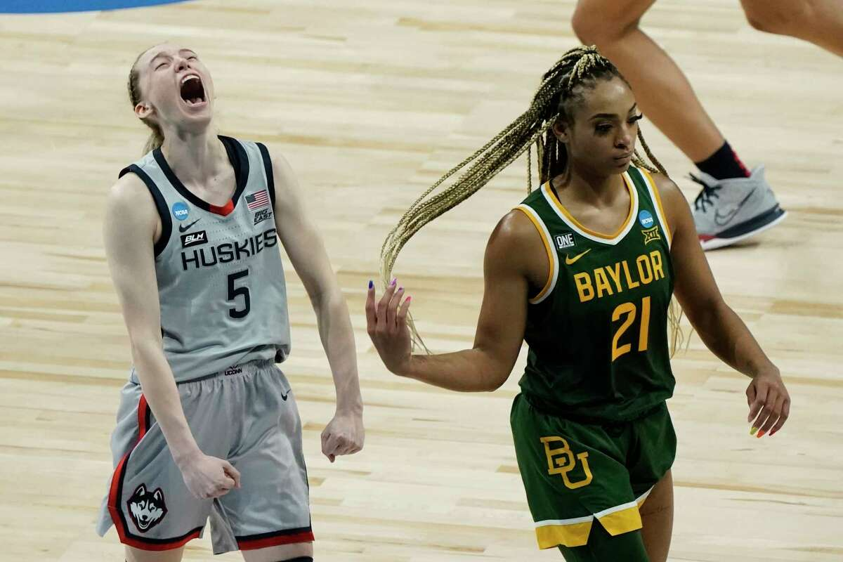 UConn's Paige Bueckers celebrates in front of Baylor's DiJonai Carrington after an NCAA college basketball game in the Elite Eight round of the Women's NCAA tournament Monday, March 29, 2021, at the Alamodome in San Antonio. UConn won 69-67 to advance to the Final Four. (AP Photo/Morry Gash)