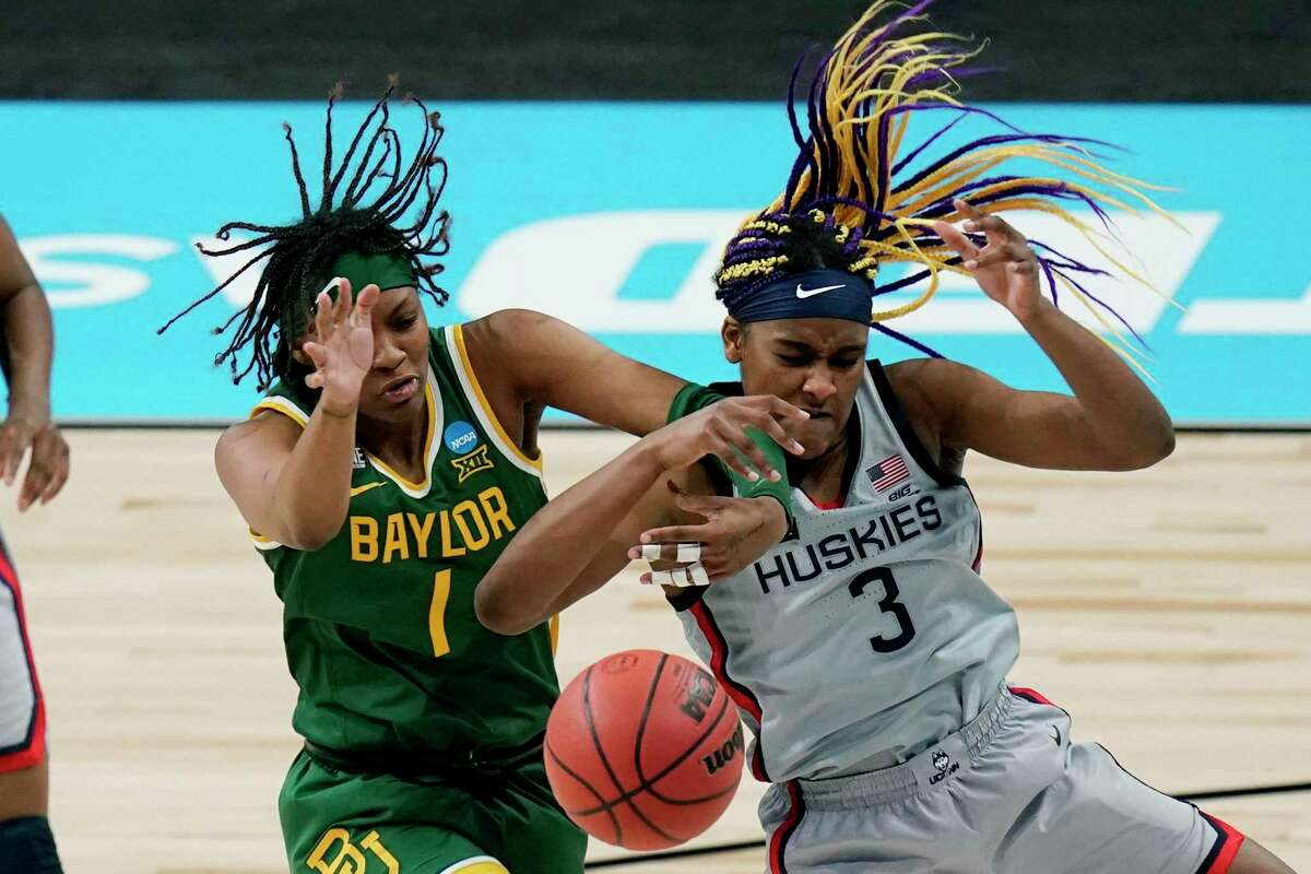 Baylor forward NaLyssa Smith (1) and UConn forward Aaliyah Edwards (3) battle for control of a rebound during the second half of a college basketball game in the Elite Eight round of the women's NCAA tournament at the Alamodome in San Antonio, Monday, March 29, 2021. (AP Photo/Eric Gay)