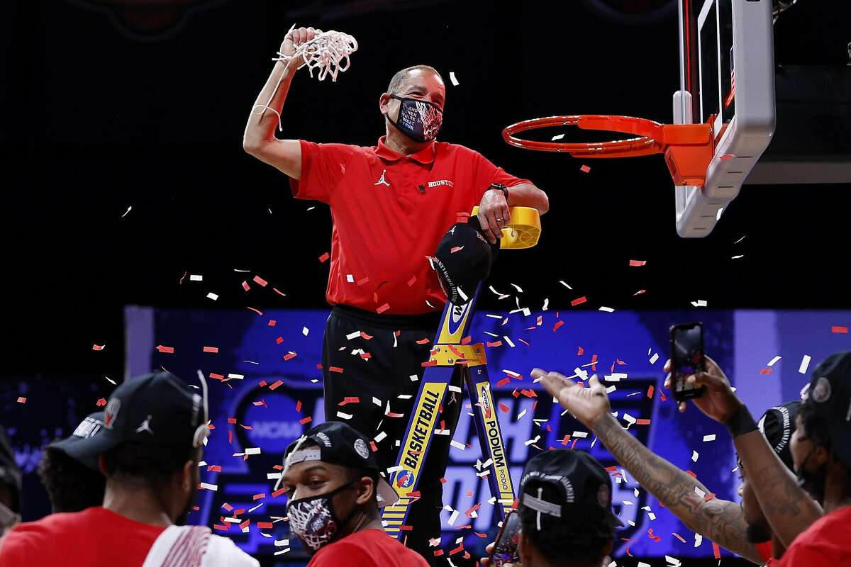 Head coach Kelvin Sampson relishes the traditional net celebration after Houston grabbed the Midwest Region title.
