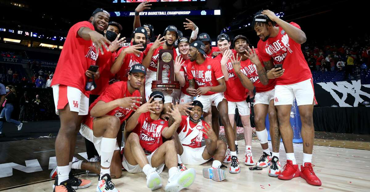 The Houston Cougars celebrate after defeating the Oregon State Beavers in the Elite Eight round of the 2021 NCAA Men's Basketball Tournament at Lucas Oil Stadium on March 29, 2021 in Indianapolis, Indiana. (Photo by Jamie Squire/Getty Images)