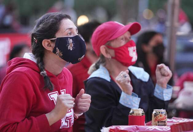 Serena Hernandez, left, and Rosa Navarro, watch the University of Houston game on an outdoor screen at Avenida Houston Monday, March 29, 2021 in Houston as UH played against Oregon State in the NCAA Tournament Midwest Region. Photo: Melissa Phillip/Staff Photographer / © 2021 Houston Chronicle