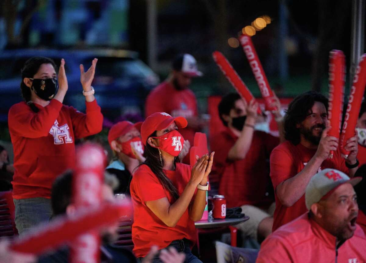 Fans cheer during a watch party at Avenida Houston for the University of Houston men's basketball game against Oregon State in the NCAA Tournament Midwest Region Monday, March 29, 2021 in Houston.