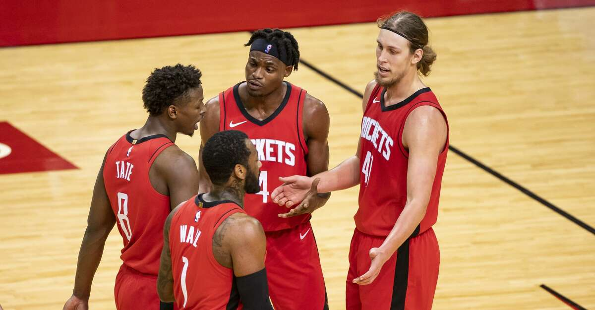 Houston Rockets forward Jae'Sean Tate (8), Houston Rockets guard John Wall (1), Houston Rockets forward Danuel House Jr. (4) and Houston Rockets forward Kelly Olynyk (41) walk back to a timeout during the second quarter of an NBA game between the Houston Rockets and the Memphis Grizzlies on Monday, March 29, 2021, at Toyota Center in Houston.