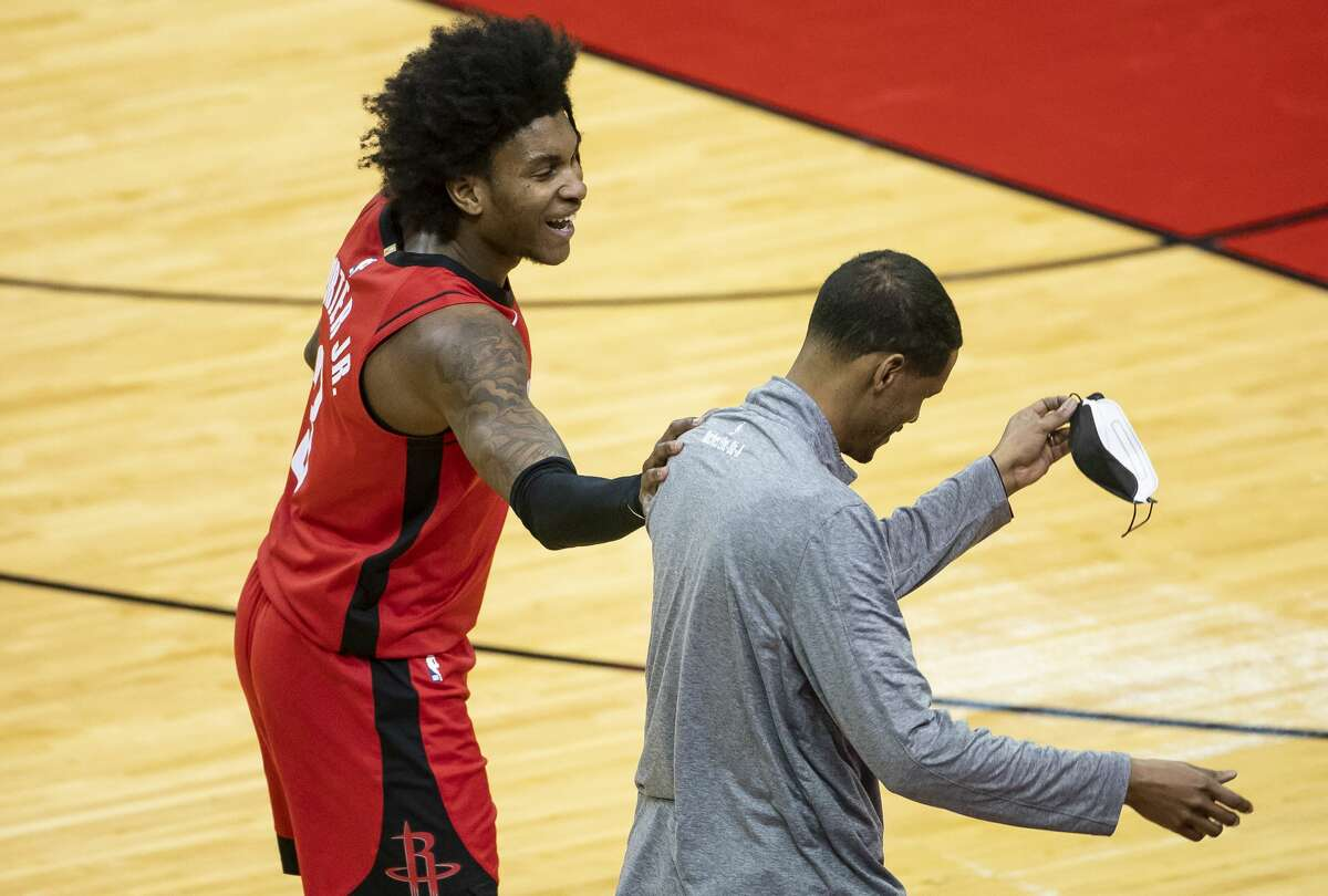 Houston Rockets guard Kevin Porter Jr. (3) laughs with Houston Rockets head coach Stephen Silas during the fourth quarter of an NBA game between the Houston Rockets and the Memphis Grizzlies on Monday, March 29, 2021, at Toyota Center in Houston.