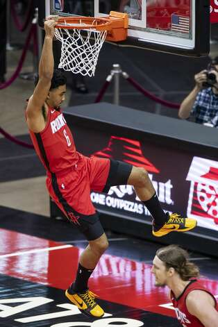Houston Rockets forward Kenyon Martin Jr. (6) slam dunks during the third quarter of an NBA game between the Houston Rockets and the Memphis Grizzlies on Monday, March 29, 2021, at Toyota Center in Houston. Photo: Mark Mulligan/Staff Photographer / © 2021 Mark Mulligan / Houston Chronicle