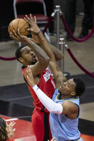 Houston Rockets forward Sterling Brown (0) shoots during the fourth quarter of an NBA game between the Houston Rockets and the Memphis Grizzlies on Monday, March 29, 2021, at Toyota Center in Houston. Photo: Mark Mulligan/Staff Photographer / © 2021 Mark Mulligan / Houston Chronicle
