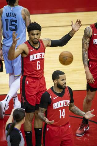 Houston Rockets forward Kenyon Martin Jr. (6) and Houston Rockets guard D.J. Augustin (14) react to a foul call during the fourth quarter of an NBA game between the Houston Rockets and the Memphis Grizzlies on Monday, March 29, 2021, at Toyota Center in Houston. Photo: Mark Mulligan/Staff Photographer / © 2021 Mark Mulligan / Houston Chronicle
