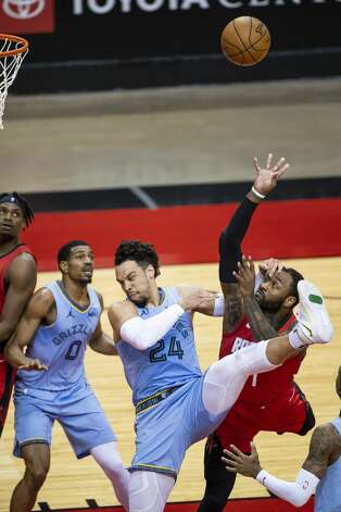Houston Rockets guard John Wall (1) shoots over Memphis Grizzlies forward Dillon Brooks (24) during the second quarter of an NBA game between the Houston Rockets and the Memphis Grizzlies on Monday, March 29, 2021, at Toyota Center in Houston. Photo: Mark Mulligan/Staff Photographer / © 2021 Mark Mulligan / Houston Chronicle