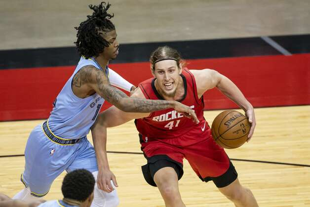 Houston Rockets forward Kelly Olynyk (41) is defended by by Memphis Grizzlies guard Ja Morant (12) during the second quarter of an NBA game between the Houston Rockets and the Memphis Grizzlies on Monday, March 29, 2021, at Toyota Center in Houston. Photo: Mark Mulligan/Staff Photographer / © 2021 Mark Mulligan / Houston Chronicle