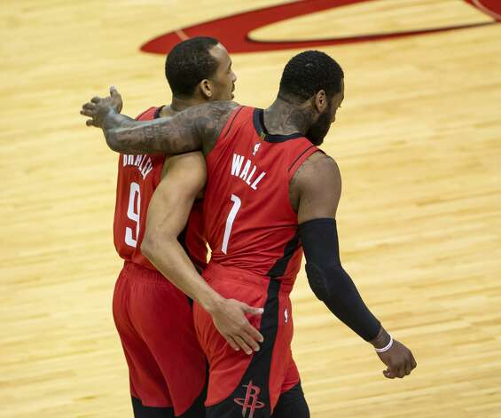 Houston Rockets guard John Wall (1) and Houston Rockets guard Avery Bradley (9) walk back to the sideline during the second quarter of an NBA game between the Houston Rockets and the Memphis Grizzlies on Monday, March 29, 2021, at Toyota Center in Houston. Photo: Mark Mulligan/Staff Photographer / © 2021 Mark Mulligan / Houston Chronicle