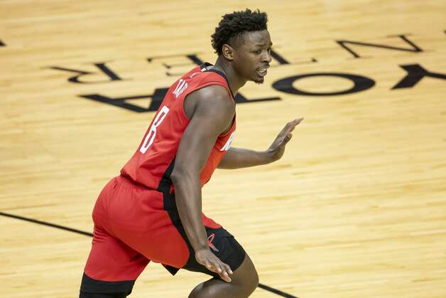 Houston Rockets forward Jae'Sean Tate (8) celebrates a dunk during the second quarter of an NBA game between the Houston Rockets and the Memphis Grizzlies on Monday, March 29, 2021, at Toyota Center in Houston. Photo: Mark Mulligan/Staff Photographer / © 2021 Mark Mulligan / Houston Chronicle
