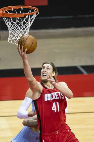Houston Rockets forward Kelly Olynyk (41) shoots during the second quarter of an NBA game between the Houston Rockets and the Memphis Grizzlies on Monday, March 29, 2021, at Toyota Center in Houston. Photo: Mark Mulligan/Staff Photographer / © 2021 Mark Mulligan / Houston Chronicle