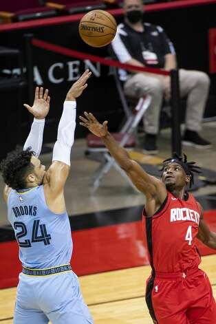Memphis Grizzlies forward Dillon Brooks (24) shoots over Houston Rockets forward Danuel House Jr. (4) during the first quarter of an NBA game between the Houston Rockets and the Memphis Grizzlies on Monday, March 29, 2021, at Toyota Center in Houston. Photo: Mark Mulligan/Staff Photographer / © 2021 Mark Mulligan / Houston Chronicle