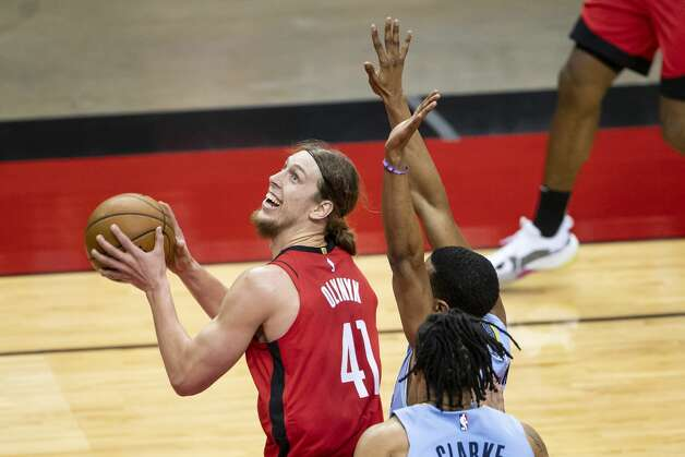 Houston Rockets forward Kelly Olynyk (41) shoots during the first quarter of an NBA game between the Houston Rockets and the Memphis Grizzlies on Monday, March 29, 2021, at Toyota Center in Houston. Photo: Mark Mulligan/Staff Photographer / © 2021 Mark Mulligan / Houston Chronicle