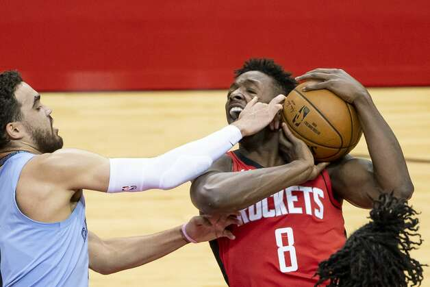Houston Rockets forward Jae'Sean Tate (8) drives to the basket during the second quarter of an NBA game between the Houston Rockets and the Memphis Grizzlies on Monday, March 29, 2021, at Toyota Center in Houston. Photo: Mark Mulligan/Staff Photographer / © 2021 Mark Mulligan / Houston Chronicle