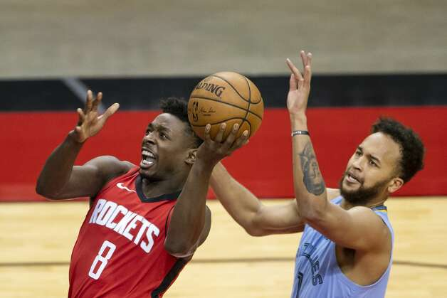Houston Rockets forward Jae'Sean Tate (8) drives past Memphis Grizzlies forward Kyle Anderson (1) during the second quarter of an NBA game between the Houston Rockets and the Memphis Grizzlies on Monday, March 29, 2021, at Toyota Center in Houston. Photo: Mark Mulligan/Staff Photographer / © 2021 Mark Mulligan / Houston Chronicle
